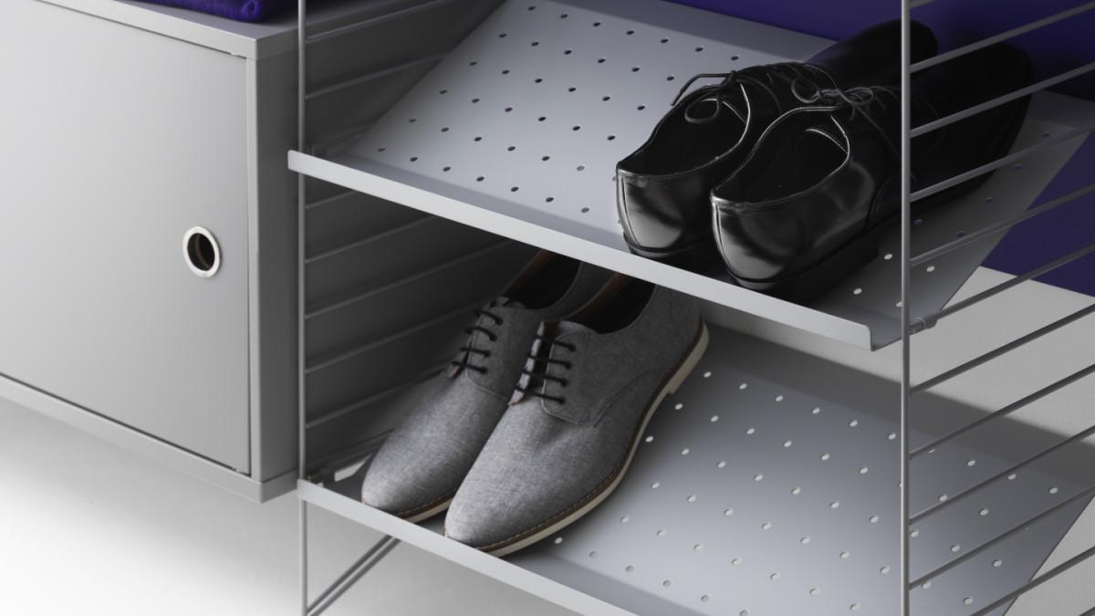 String shelf perfect for your hallway. Floor panels, metal shelves, shoe shelves, cabinet with swing door in grey.