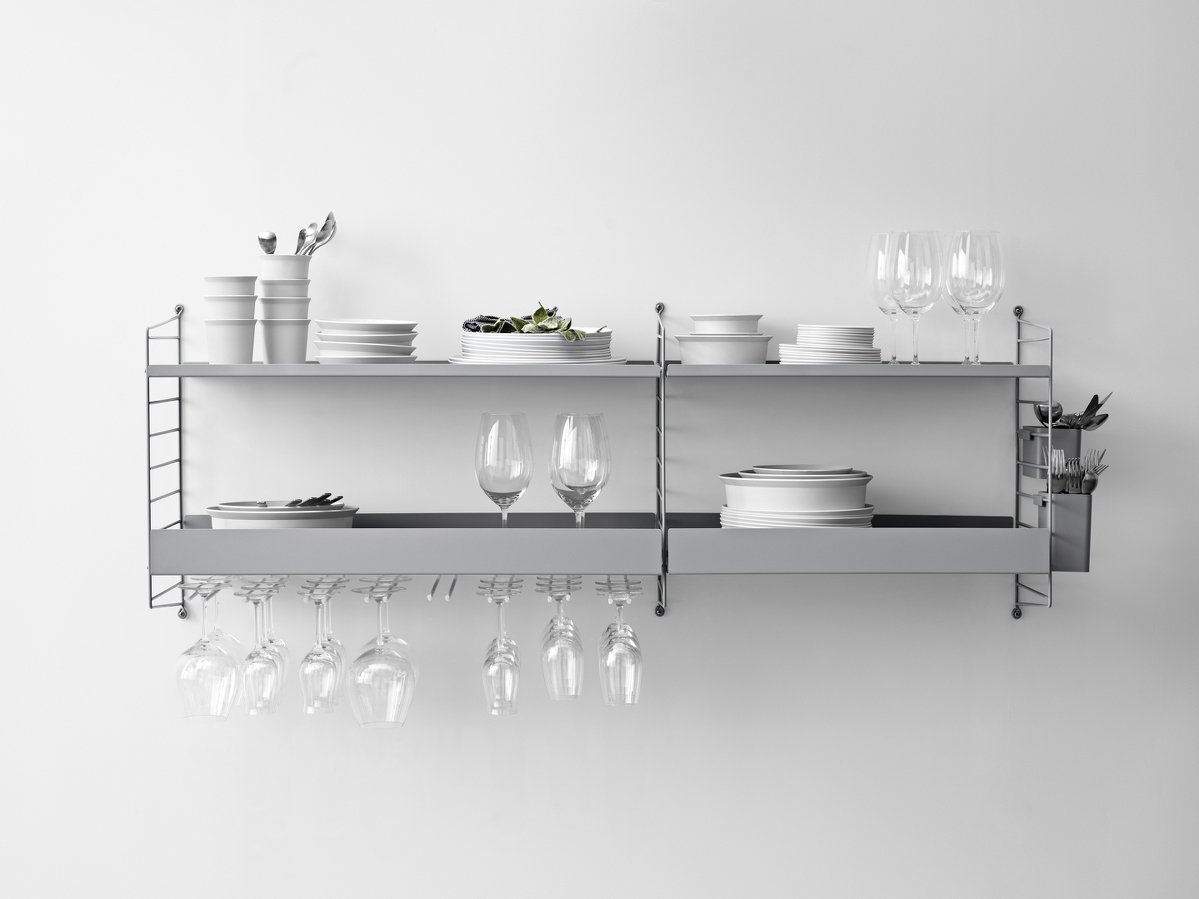 Wall mounted kitchen solution from String. Wall panels, metal shelves, hanger racks and organizers in grey.